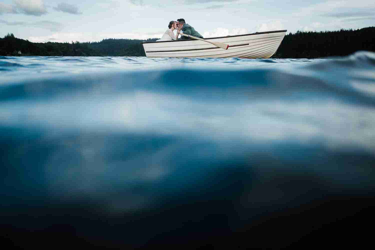 A wedding portrait from in the water at Loch Ard