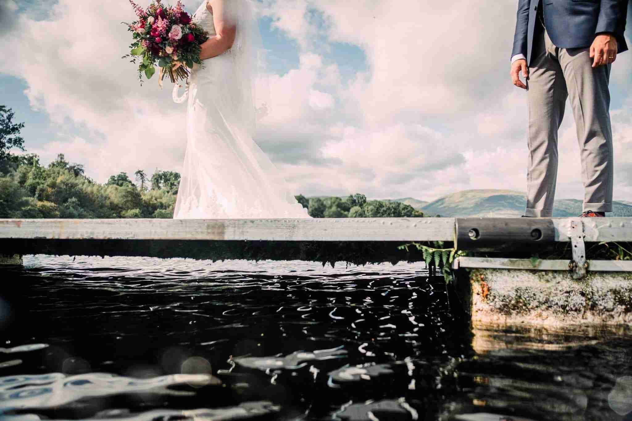 A wedding portrait of a couple on a jetty at the Cruin, Loch Lomond