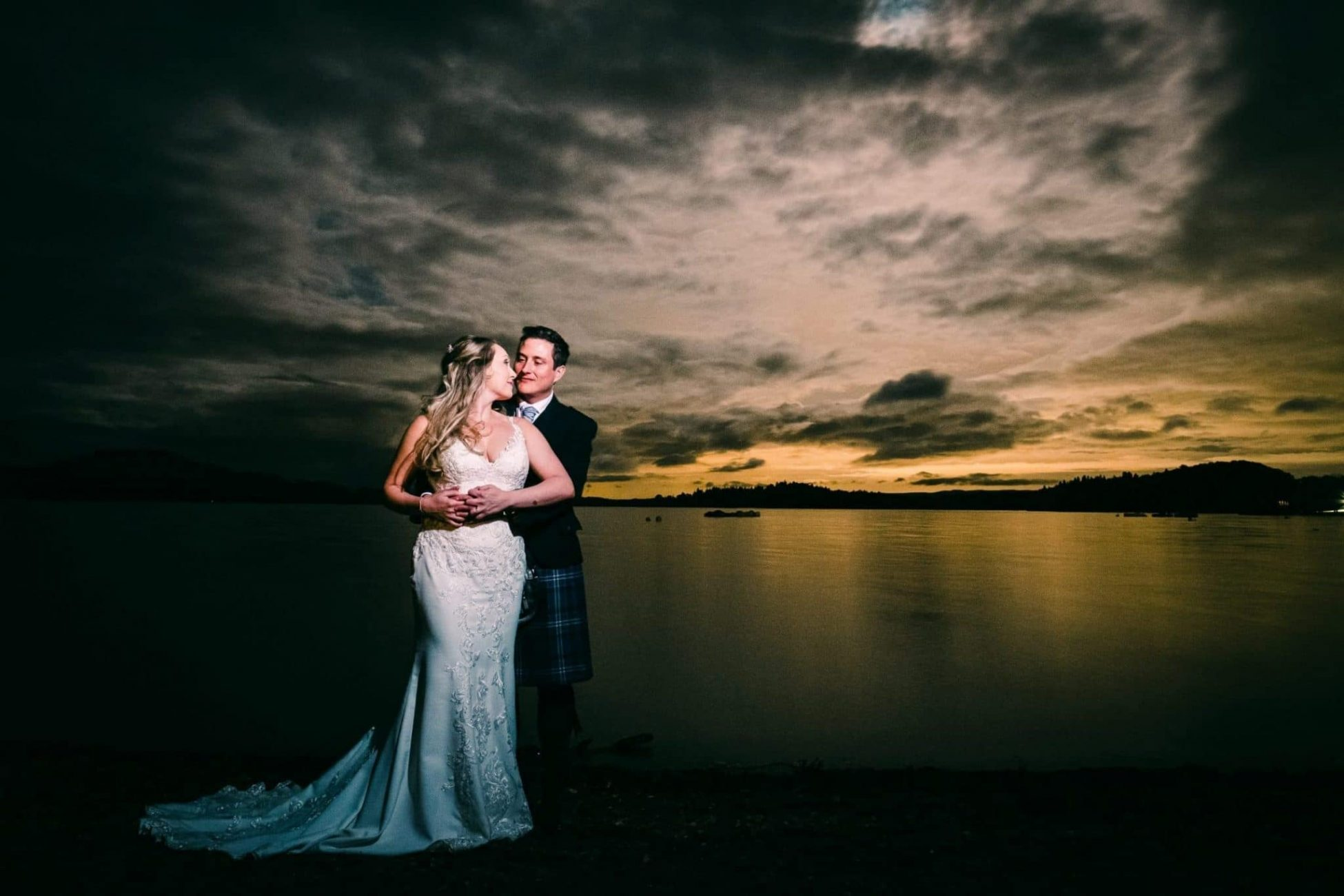 A wedding portrait at night at Loch Lomond